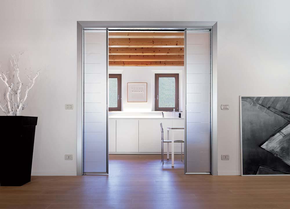 Puertas correderas tipologia de puerta empotrada eclisse - Puerta corredera abatible ...